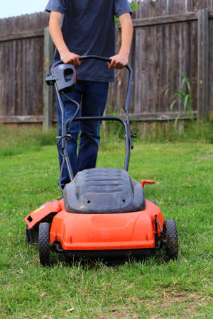 Close up view of someone mowing the lawn photo