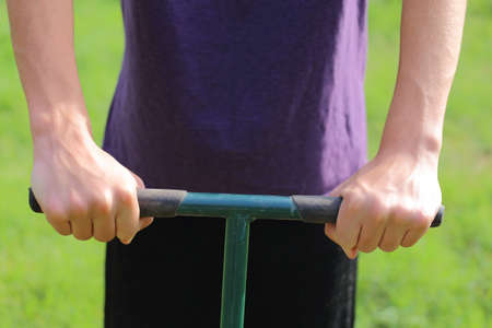 Someone using handles to garden, till, or lawn care  Stock Photo