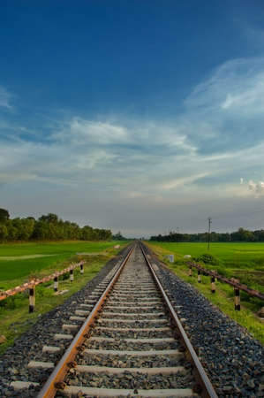Infinity Rail tracks on the gravel path through the paddy fields