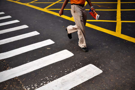 passerby: Urban man crossing the road