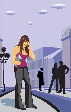 Businesswoman holding a file and talking on a mobile phone photo