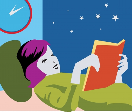 lying in bed: Girl reading book while lying on bed Stock Photo