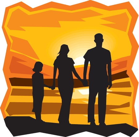 Rear view of family standing by the sea at sunset photo