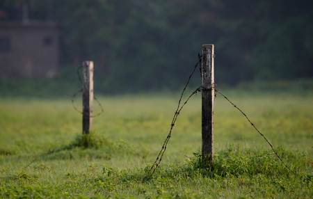 Couple of posts with the fences broken in a remote village Stock Photo