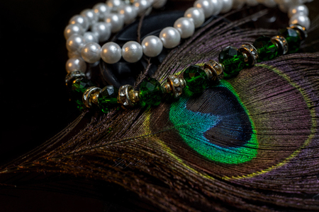 Pearls Emeralds and Peafowl Feathers Stock Photo