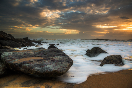 thorium: A beautiful sunset in the rocky beaches of Southern Kerala, India
