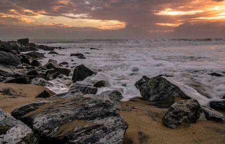thru: Seawaves Flowing thru beach rocks