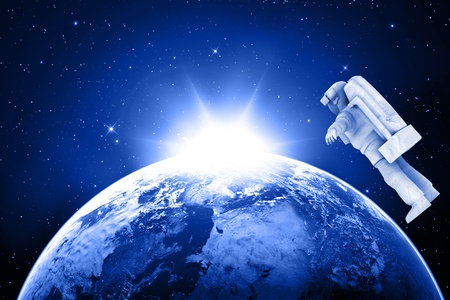 dimensionally: blue planet earth and astronaut in space  Stock Photo