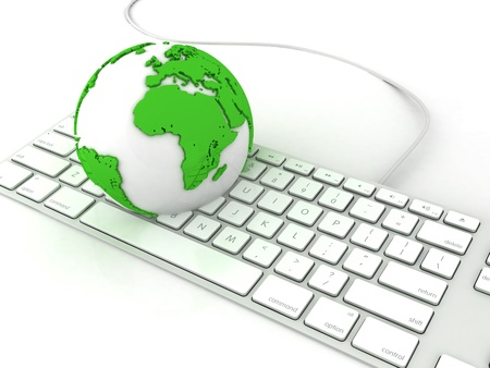Earth globe over keyboards computer photo