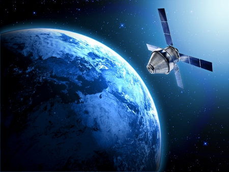 blue planet earth and satellite in space photo