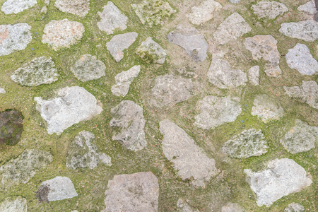 cobble: cobblestone with grass texture , stone pathway with grass  background Stock Photo