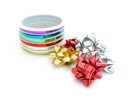 Packaging ribbons and bows on white  photo