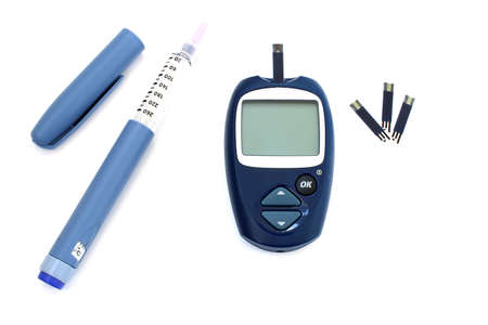 Diabetic kit:  syringe pen with insulin and glucometer photo