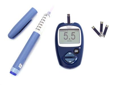 diabetes meter kit: Syringe pen with insulin and blood glucose meter showing normal blood glucose Stock Photo