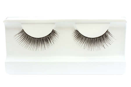 Pair of false eyelashes in a box on a white background photo