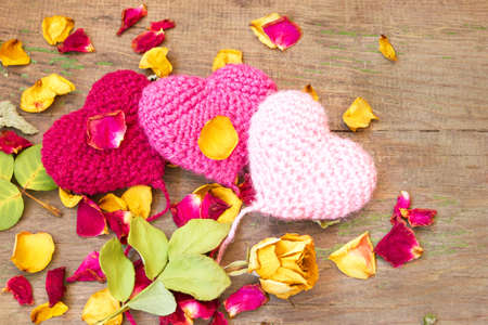 cute knitted valentine s hearts on a wooden background  photo