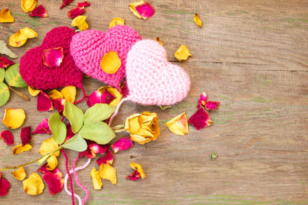 knitted valentine s hearts on a wooden background  photo