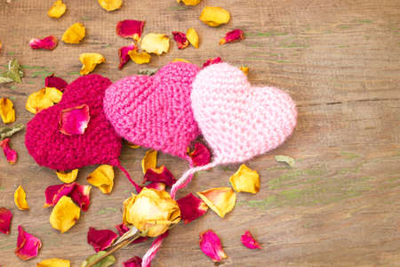 cute knitted hearts on a wooden background  photo