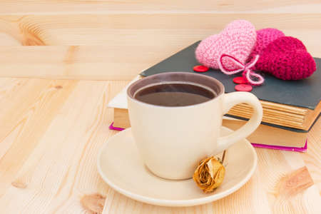 morning coffee, books and knitted hearts  photo