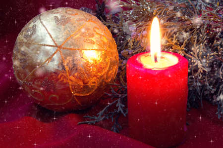 beautiful red candle and christmas ball  photo