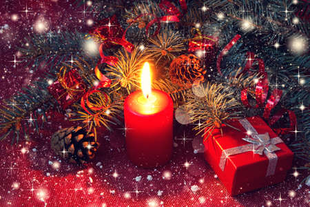 red christmas candle and gift box on a shiny background  photo