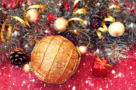shiny golden ball and decorated christmas tree branches  photo