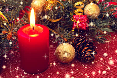 red candle and lovely christmas decorations  photo