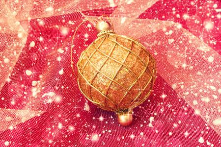 golden ball on snowy shiny background  photo