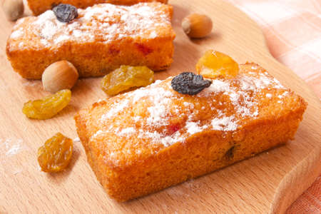 baked yummy fruitcake with raisins  photo