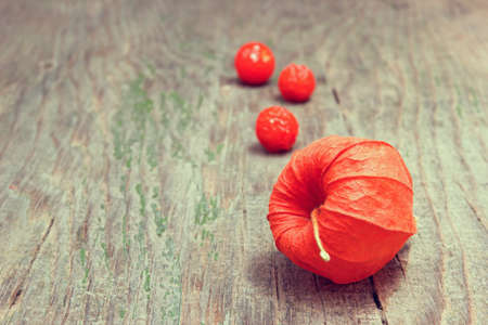 cape gooseberries on a wooden background close up photo