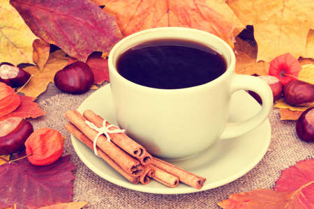 warming cozy coffee and autumnal leaves photo