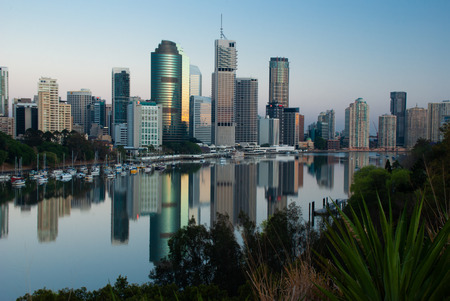 Brisbane CBD at sunrise reflected in a calm Brisbane River
