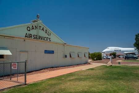 The Qantas Museum in Longreach, Australia with an old hangar and a Boeing 747 jumbo jet parked