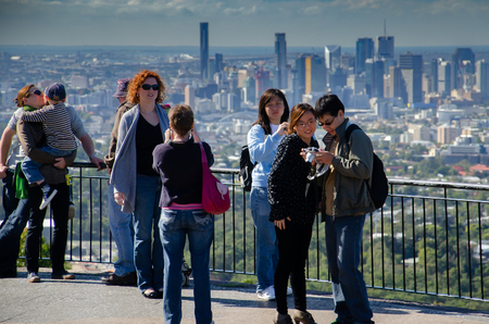 Tourists take advantage of Mt Coot-tha lookout to take pictures of Brisbane City Centre Sajtókép