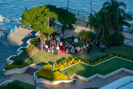 A popular place for weddings in Brisbane. The Landing at Dockside hosts the wedding on the lawn just beside the Brisbane River. Stock fotó
