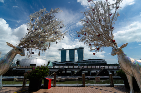 Singapore prepares for Christmas celebrations with traditional northern hemisphere decorations framing Marina Bay Sands Hotel in the background