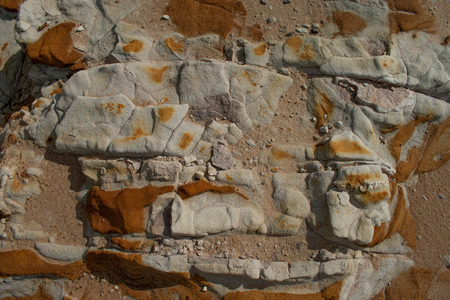 A limestone rock outcrop with different bands of rock, color and patterns Stock Photo