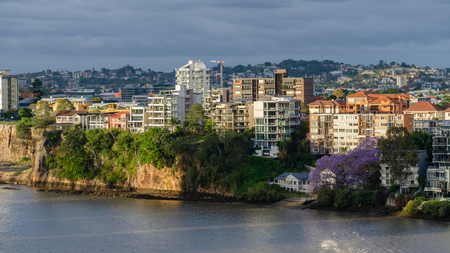 Brisbane apartments at sunset with the city in full bloom with jacaranda trees