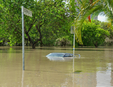 The 2010-11 Brisbane floods caused a lot of damage. Here a car is submerged in deep floodwater in Kangaroo Point, Brisbane Standard-Bild