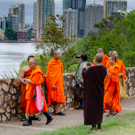 Buddhist Monks take photographs of each other in Brisbane, Queensland