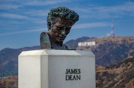 At the Griffith Observatory this bust of film star James Dean is seen here overlooking the Hollywood sign in Los Angeles