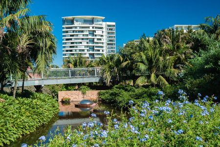 Apartments overlooking a pond in Brisbane Botanical Gardens