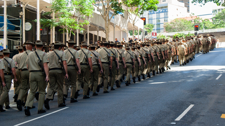 A large column of soliders marching in the Anzac Military Parade, Brisbane Sajtókép