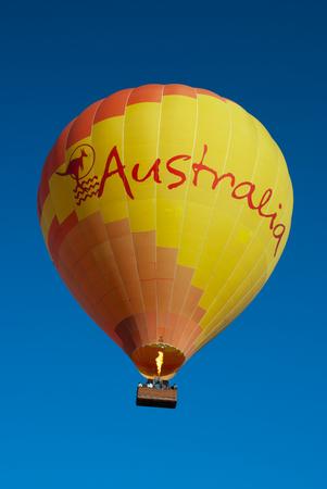 Hot air balloon set against a clear blue sky Sajtókép