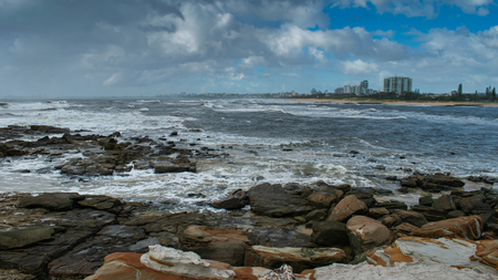 Maroochydore apartments and beaches as seen from North Shore on a showery day