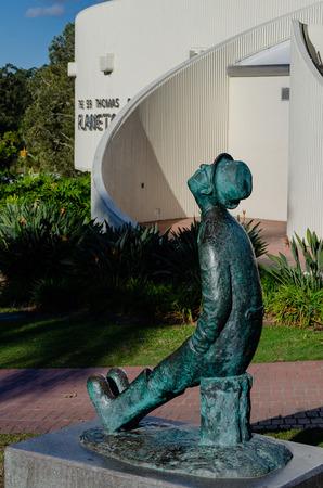 A statue outside Sir Thomas Brisbane Planetarium looks to the sky