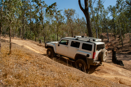 A Hummer vehicle drives a rough 4wd track