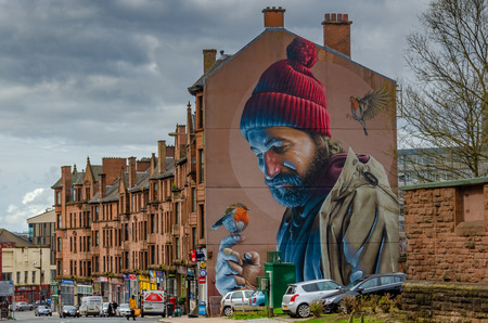 A gable end artwork by Simon Bates represents Mungo, Glasgow's patron saint, in modern day clothes. 新闻类图片