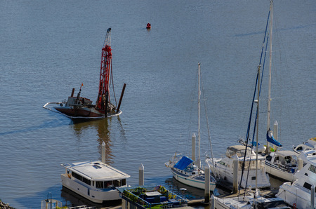 A drilling rig in the process of sinking in the Brisbane River