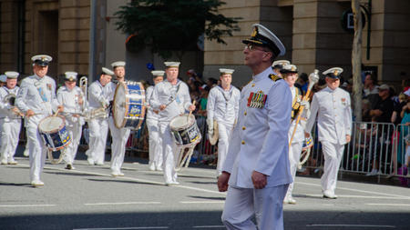Brisbane hosts an Anzac Day parade. Here a proud navy officer matches in front of his fellow men. Sajtókép